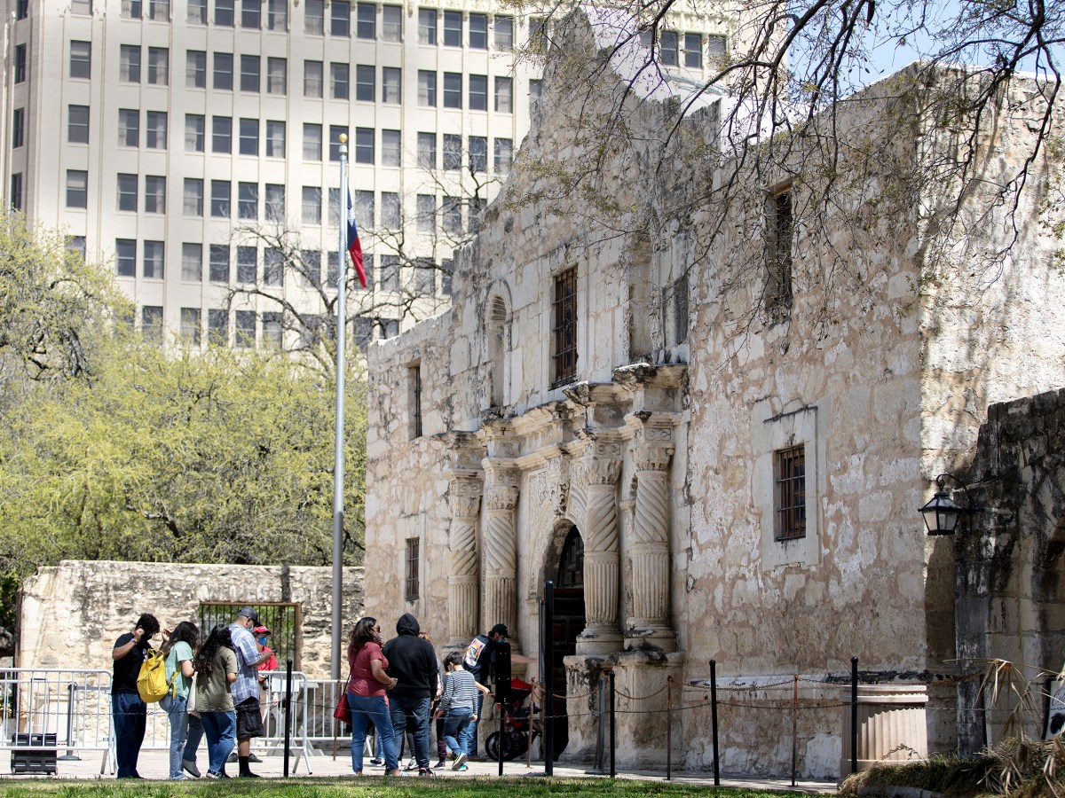 Visitors to the Alamo wait in line to tour the church on Tuesday in San Antonio.