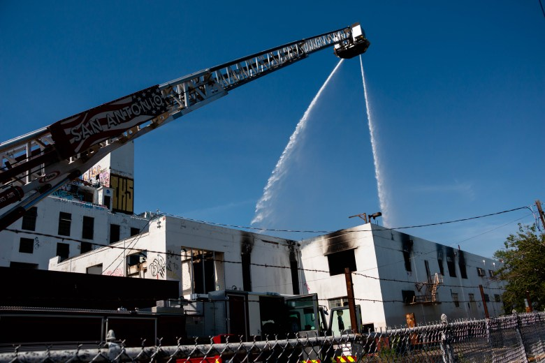 San Antonio Firefighters work to quell the fire and smoke at the Lone Star Brewery