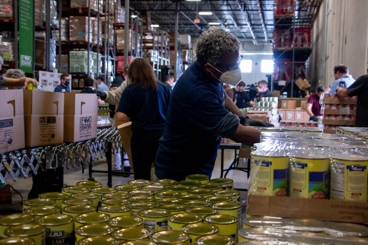 Volunteers from St. Mary's Law School volunteer at the San Antonio Foodbank during National Volunteer Month.
