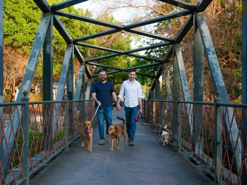 Levi Stoneking and Jimmy Moore love taking their three dogs for a walk across the Arsenal Street Bridge in the historic King William district.