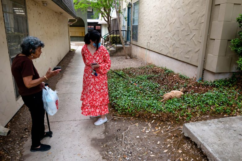 Allysse Shank-Rivas catches up with her neighbor, Alicia, while taking her twelve-week-old puppy, Potato, for a walk.