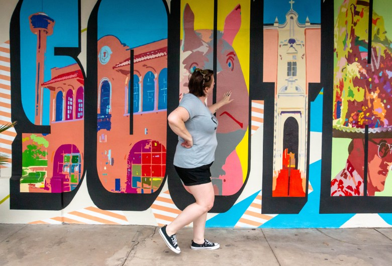 "Bridget walks by the ""Southtown"" mural painted outside of Taco Haven on S Presa Street."