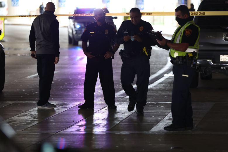 Police officers stand outside Terminal B at the San Antonio International Airport where gunfire was reported Thursday.