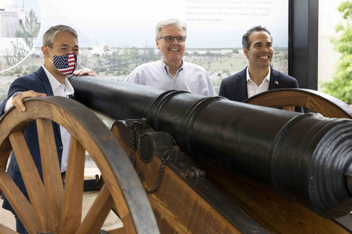(from left) Mayor Ron Nirenberg, Lt. Gov. Dan Patrick, and Texas Land Commissioner George P. Bush unveil 'the 18-pounder' a replica cannon that sits atop a new experience above a replica Losoya house North of the Alamo Church.