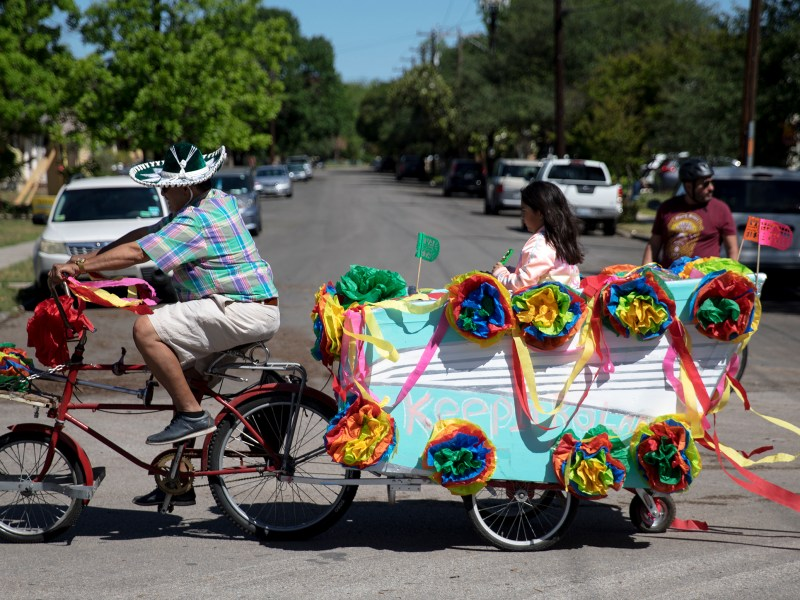 People participate in the inaugural Fiesta Bike Parade on Saturday.