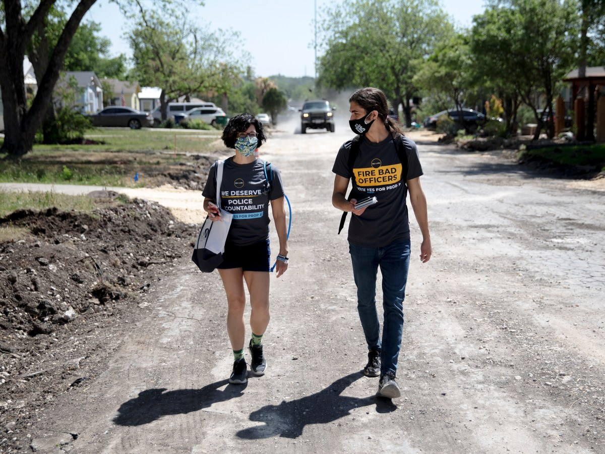 Fix SAPD volunteer Deborah Martin, left, and board member James Dykman block walk to raise support for Proposition B on April 10.
