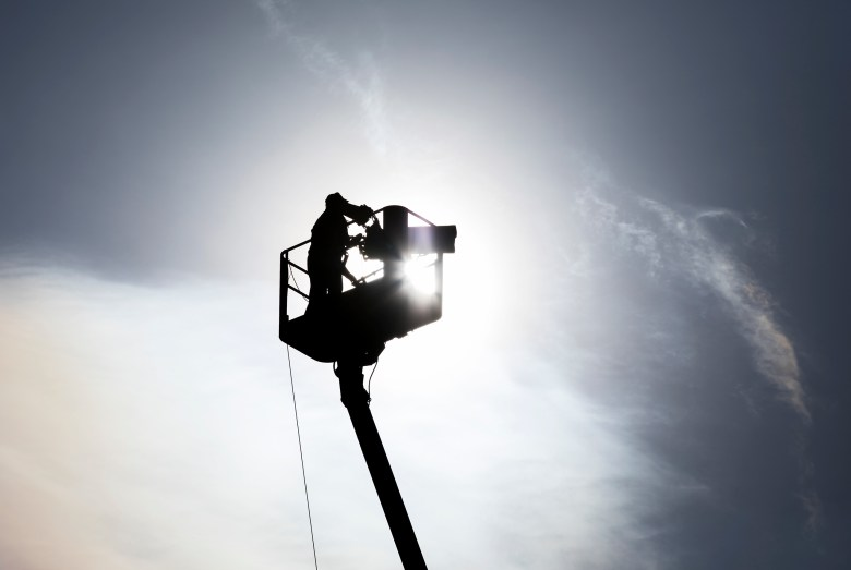 A broadcast camera operator works from a tower during the Texas Open at TPC San Antonio on Friday.