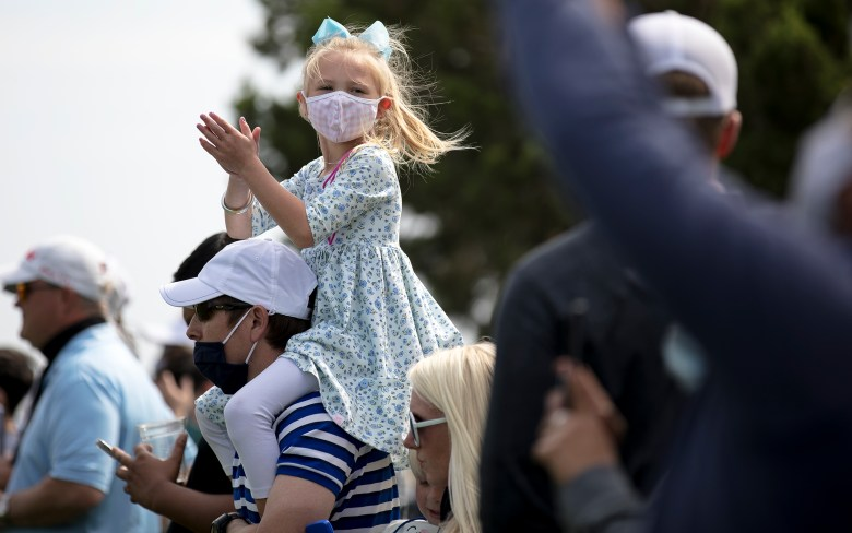 A girl cheers on a golfer during the Texas Open at TPC San Antonio on Friday.
