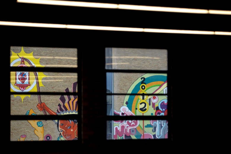 """Muralist Rudy Herrera's """"The Last Parade"""" adorns the nine-story Kress building in downtown on Thursday."""