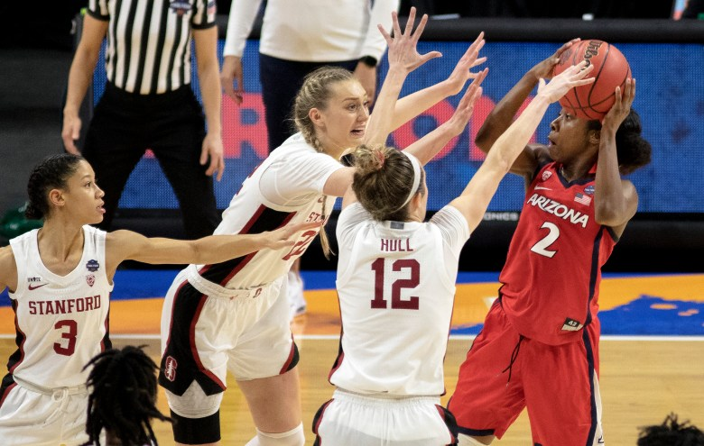 Arizona guard Aari McDonald (2) shoots a last-second shot over Stanford forward Cameron Brink (22) and guard Lexie Hull (12) during the championship game in the women's Final Four NCAA college basketball tournament on Sunday at the Alamodome. Stanford held off an Arizona comeback to win the title, 54-53.