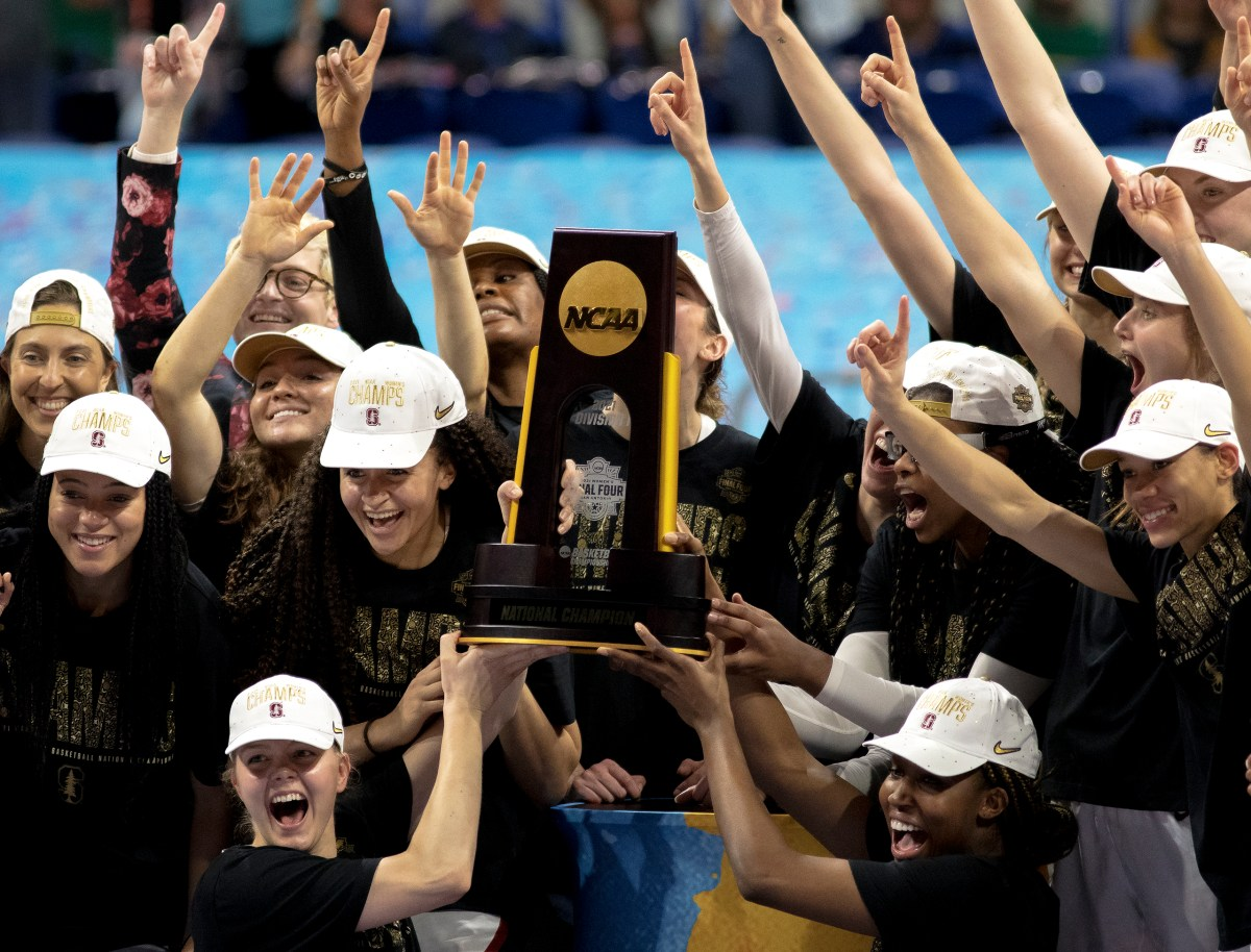Stanford celebrates its win over Arizona in the championship game in the women's Final Four NCAA college basketball tournament on Sunday at the Alamodome. Stanford held off an Arizona comeback to win the title, 54-53.