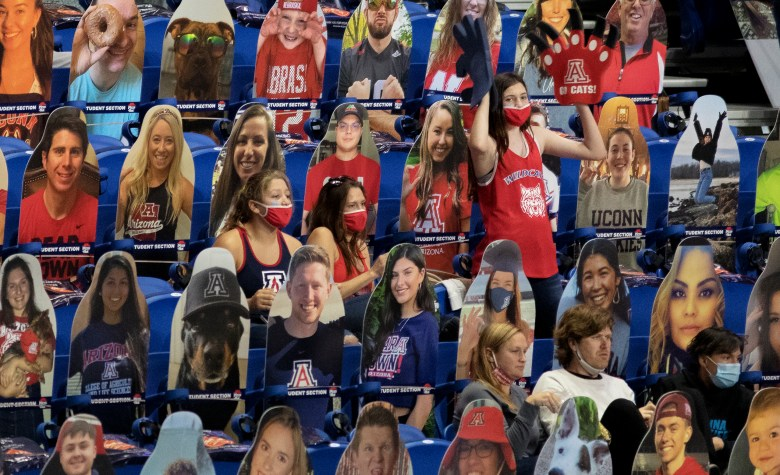 Among rows of cardboard cutouts, an Arizona fan cheers on her team against Stanford during the championship game in the women's Final Four NCAA college basketball tournament on Sunday at the Alamodome. Stanford held off an Arizona comeback to win the title, 54-53.