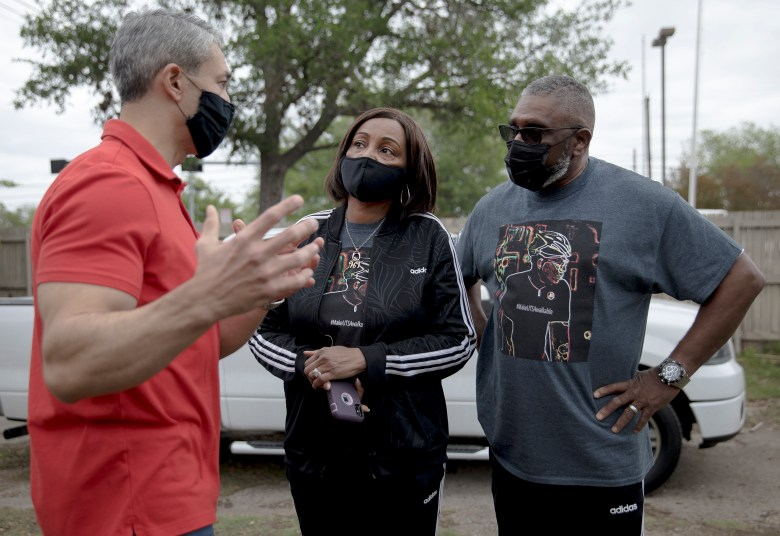 Mayor Ron Nirenberg, left, speaks with Harry and Bernice Bradshaw, parents of Tito Bradshaw, during an event honoring Tito on Saturday. Tito Bradshaw, a beloved local cyclist, was struck and killed by an alleged drunk driver on April 1, 2019, on East Houston Street. Family members and friends gathered to demand justice for Tito and urge city officials to approve a bike-safe infrastructure plan.