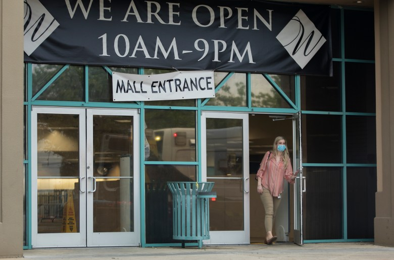 A woman exits the Wonderland of Americas shopping center on Thursday.