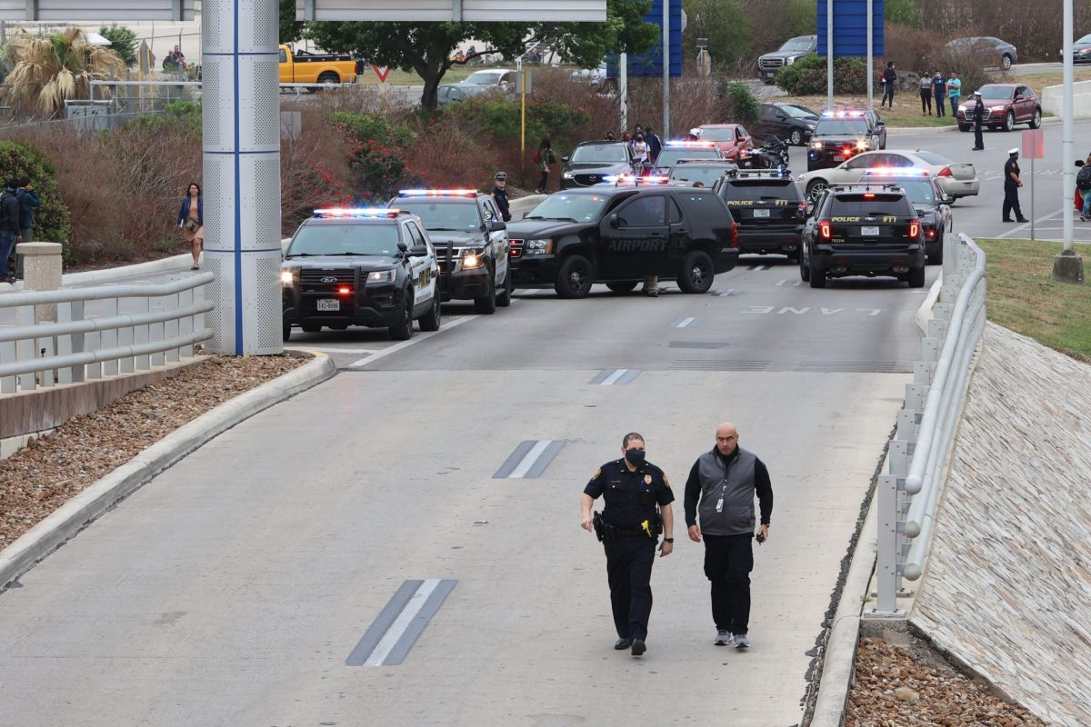 The San Antonio International Airport was put on lockdown after an officer fatally shot a gunman near the entrance to Terminal B.