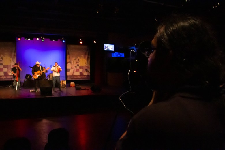 A camera man records a live performance with the Texamaniacs at the Guadalupe Theatre. The Conjunto Festival in 2021 will be virtual.
