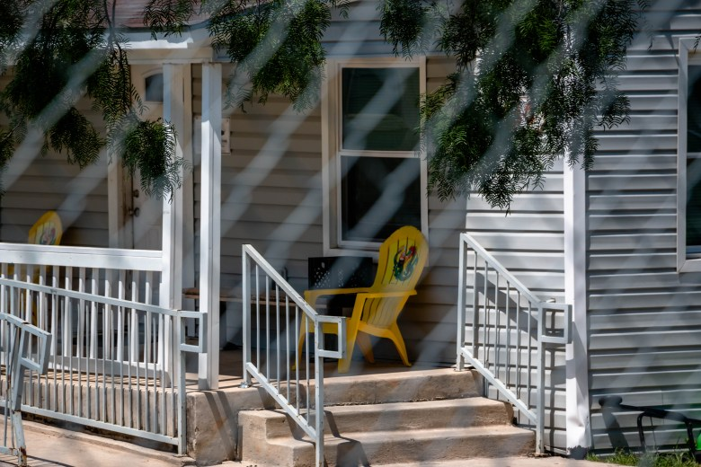 A yellow adirondack chair sits on the front porch of the George Gervin Basic Center.