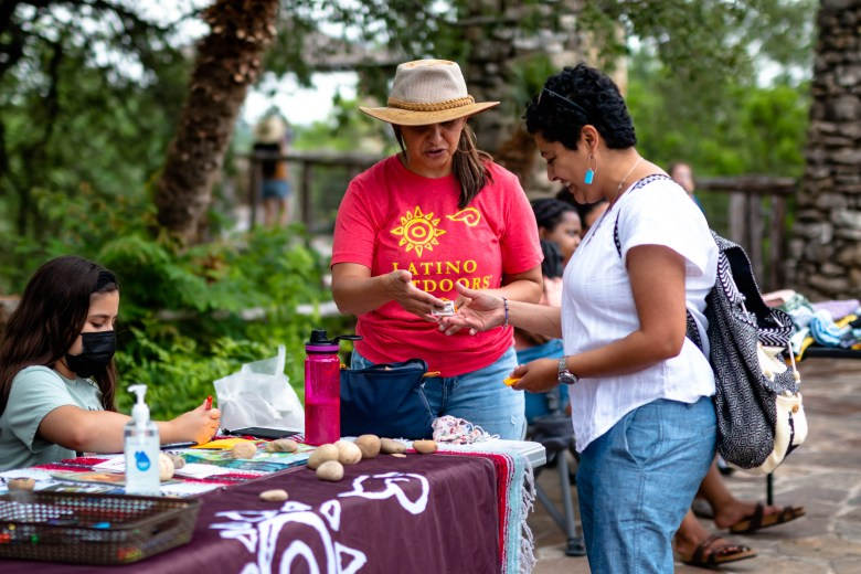 Josie Gutierrez, Latino Outdoors Program Coordinator, shares information with a visitor at the Outside For All event at the Japanese Tea Garden.