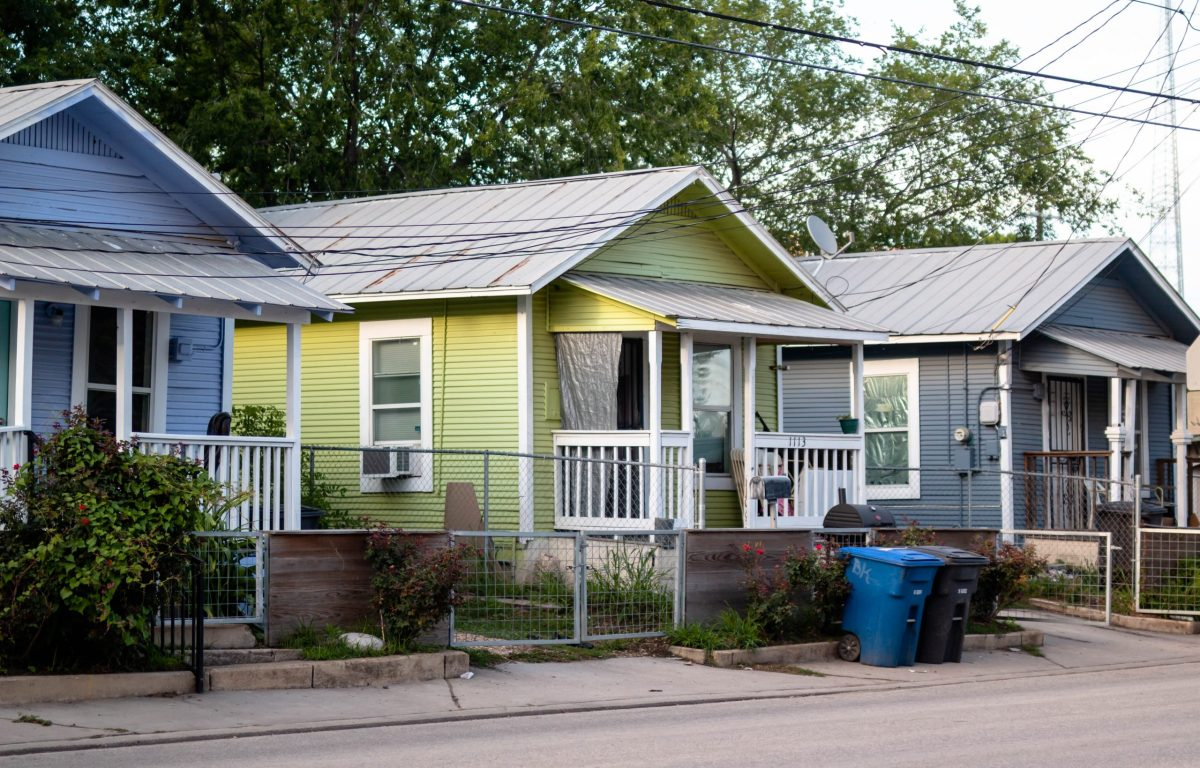 Three shotgun homes located on Guadaulupe Street between S Brazos and Colorado Streets.