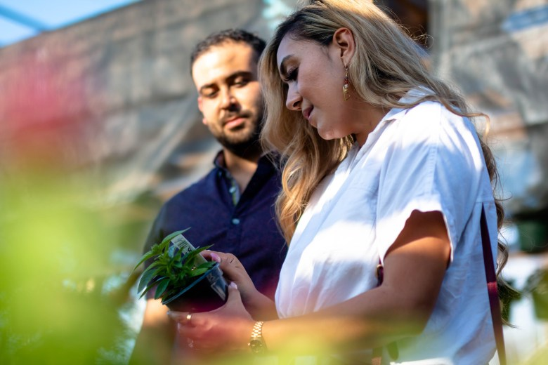 Sophia Campos eyes a new plant at Evergreen Garden with her fiancé, Adam Pena. The engaged couple enjoy visiting the local business all within a short distance from their home in Beacon Hill.