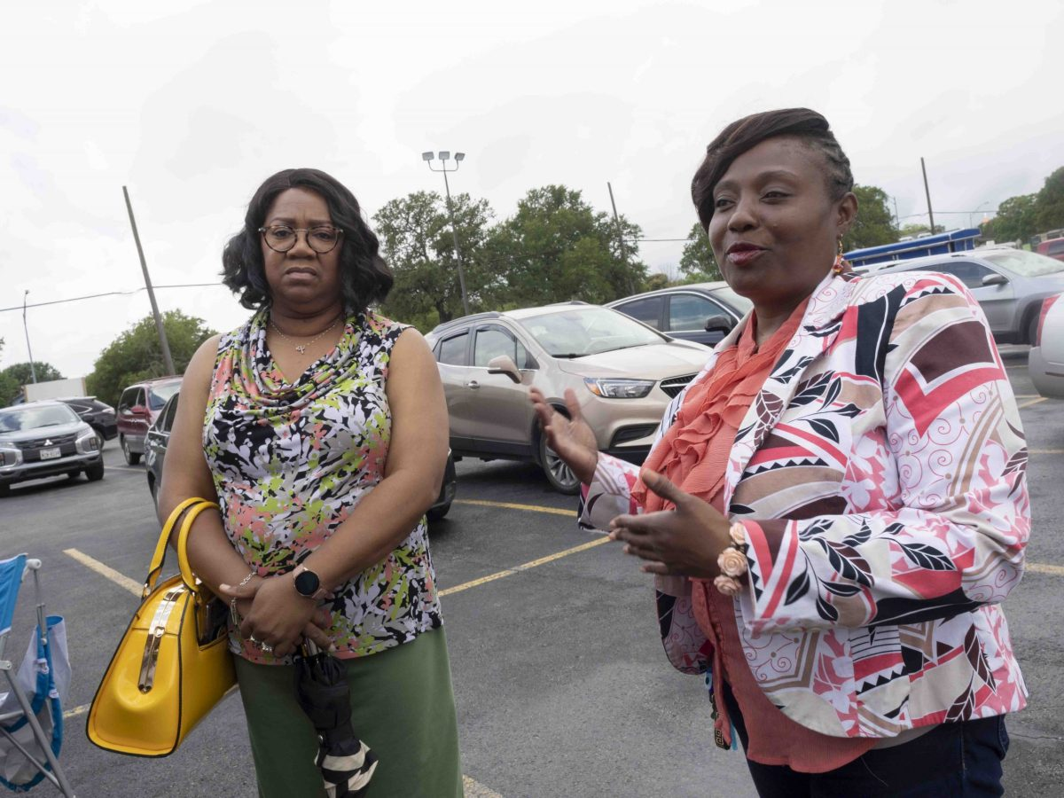 Supporters and former opponents of Jada Andrews-Sullivan, right, assemble in solidarity on getting the incumbent reelected in District 2.