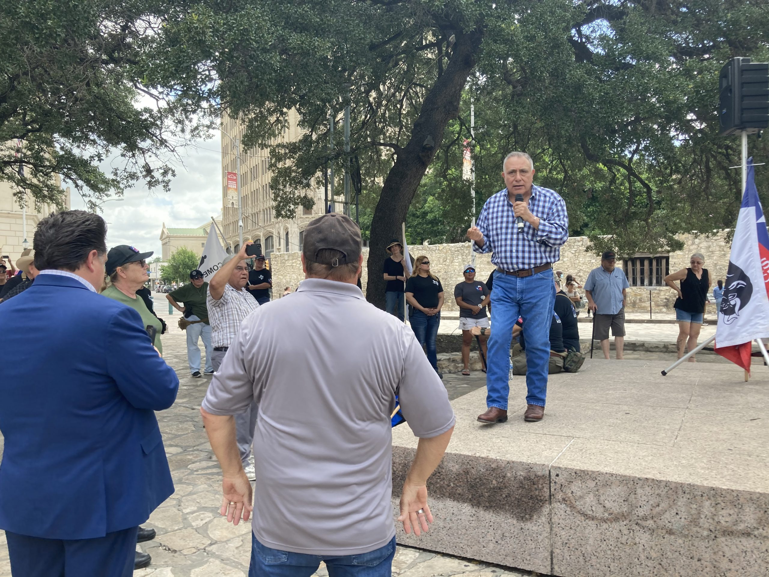 George Rodriguez, a member of This is Texas Freedom Force, protests LULAC's statements on the Alamo at the Cenotaph monument on Friday.