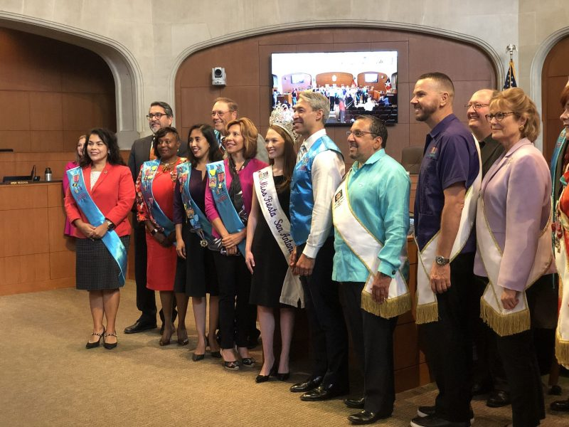 Mayor Ron Nirenberg and City Council members pose for a photo donned in Fiesta sashes after giving the green light for Fiesta events later this month.