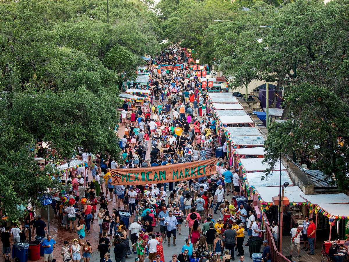 Thousands of people walk through vendor-filled streets during A Night in Old San Antonio on Tuesday.