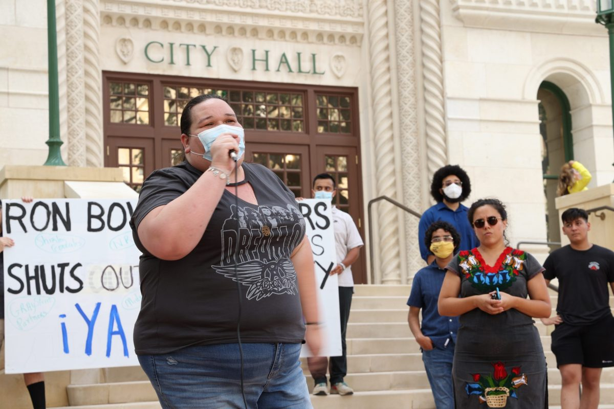 Kayla Miranda, public housing resident, joins other housing advocates on the steps of City Hall to implore Mayor Nirenberg not to appoint Shirley Gonzalez to the city's Housing Commission on Wednesday.