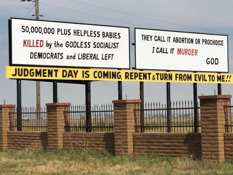 Bilboards lamenting the practice of abortion greet drivers in West Texas.