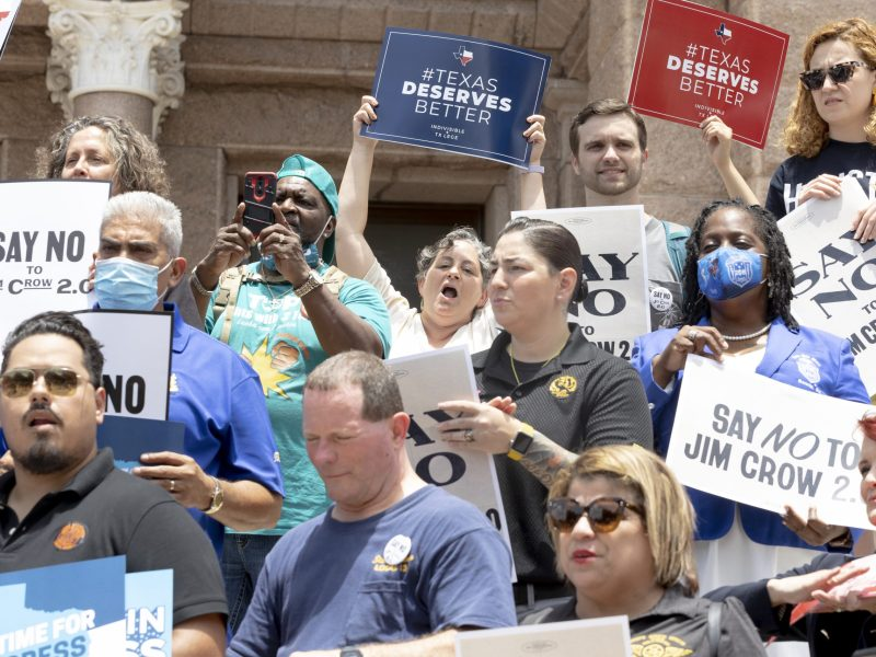 Union members, activists, and other organizers gather in front of the Texas State Capital in opposition to legislation that would eliminate drive-thru voting and 24 voting centers along with further restricting votes by mail.