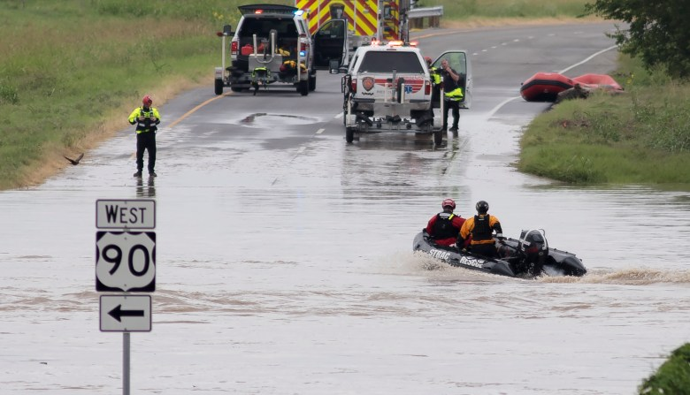 A rescue boat returns to a San Antonio Fire Department staging area after searching Leon Creek floodwaters near U.S. 90 on Tuesday.