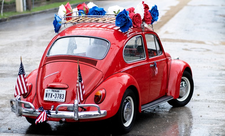 A Volkswagen Beetle decorated with Americana decor is seen in the Monte Vista Historical Association annual Fourth of July parade on Sunday.