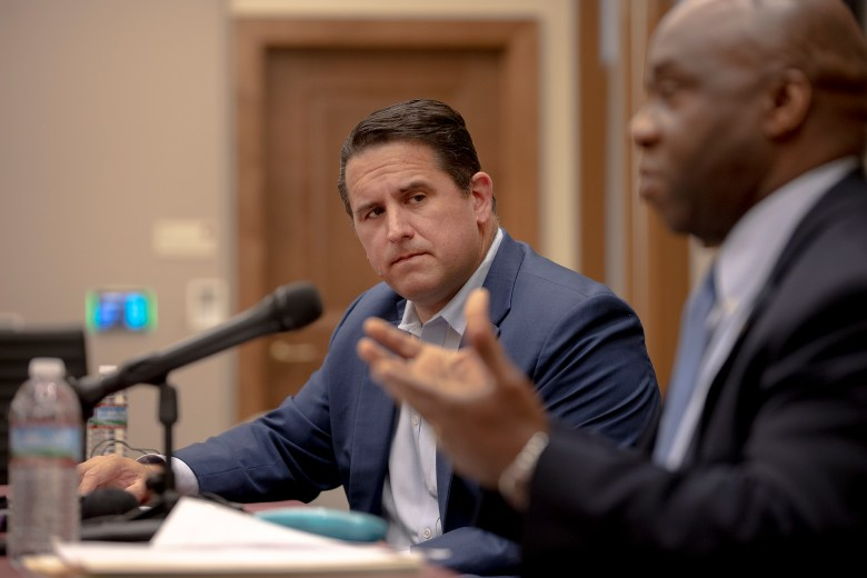 City Manager Erik Walsh listens to Metro Health Director Claude Jacobs speak during a press conference at City Hall on Thursday.