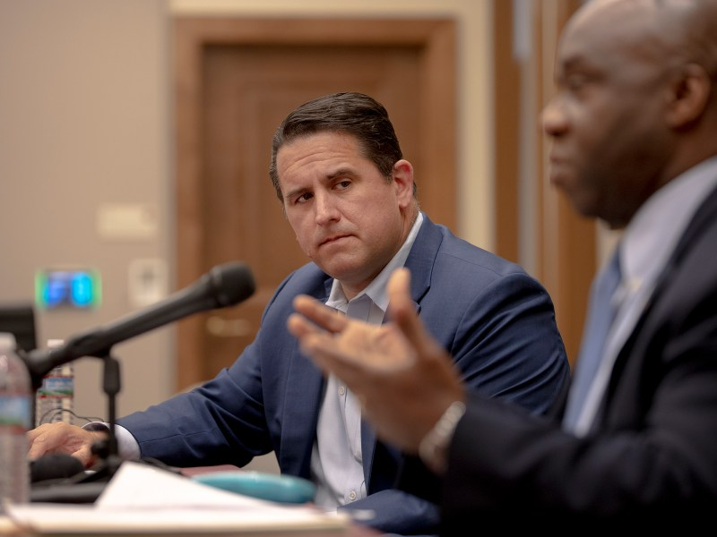 City Manager Erik Walsh listens to Metro Health Director Claude Jacob speak during a press conference at City Hall on Thursday.