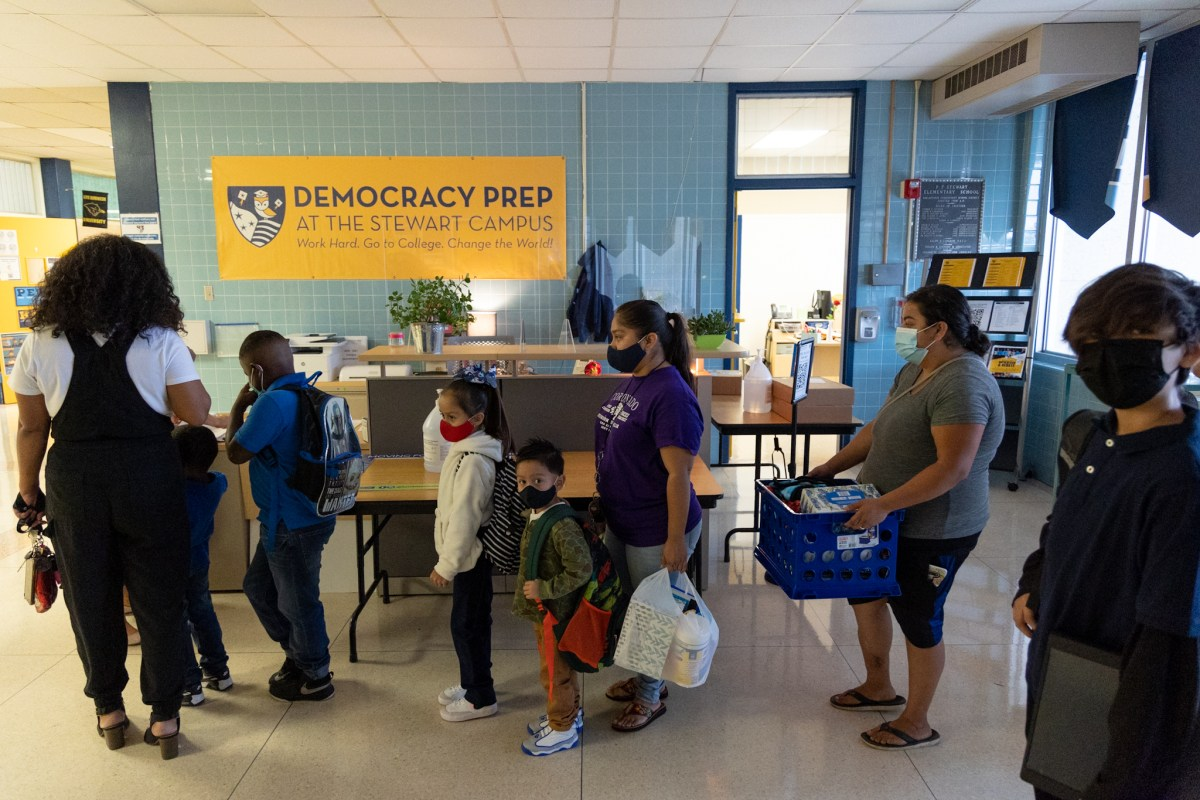 Students and families arrive to Democracy Prep at the Stewart Campus on the first day of school.