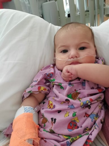 Isabella, 4-months, is photographed while hospitalized for a variety of viruses including COVID-19 in early August.