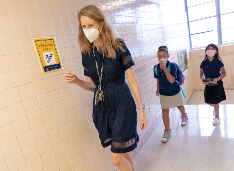 Democracy Prep Principal Virginia Boyce leads students to their new classroom on the first day of school.