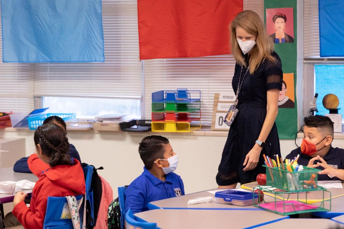Democracy Prep Principal Virginia Boyce visits a fifth-grade classroom on the first day of school.