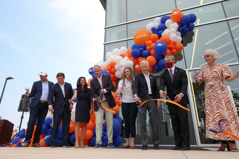 University representatives and local officials cut the ribbon opening the Roadrunner Athletic Center of Excellence