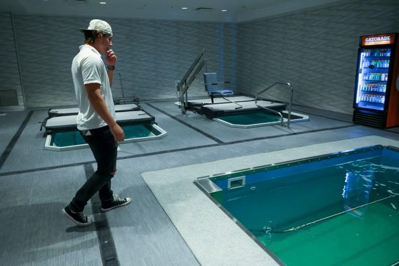 UTSA Linebacker Tyler Lahmke tours the new in-ground aquatic underwater treadmills.