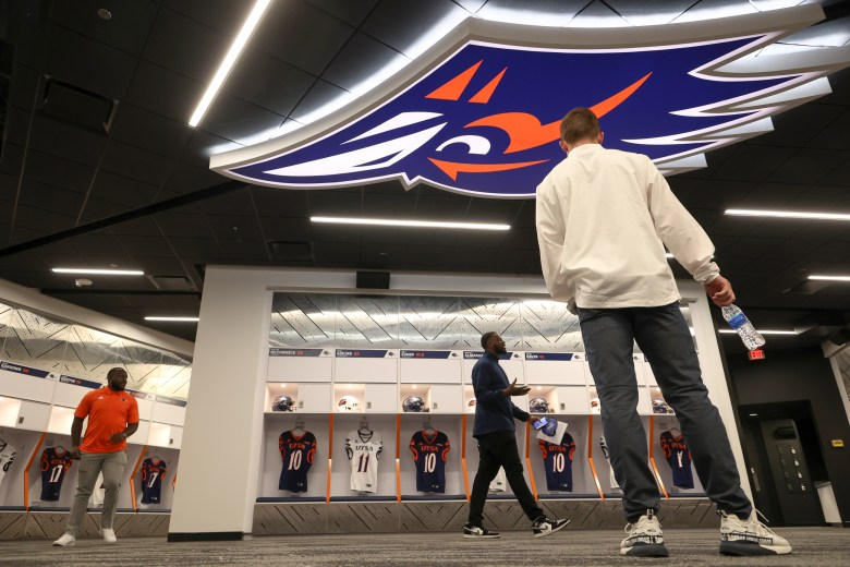 Athletes and staff tour the new football locker rooms at the Roadrunner Athletics Center of Excellence (RACE).