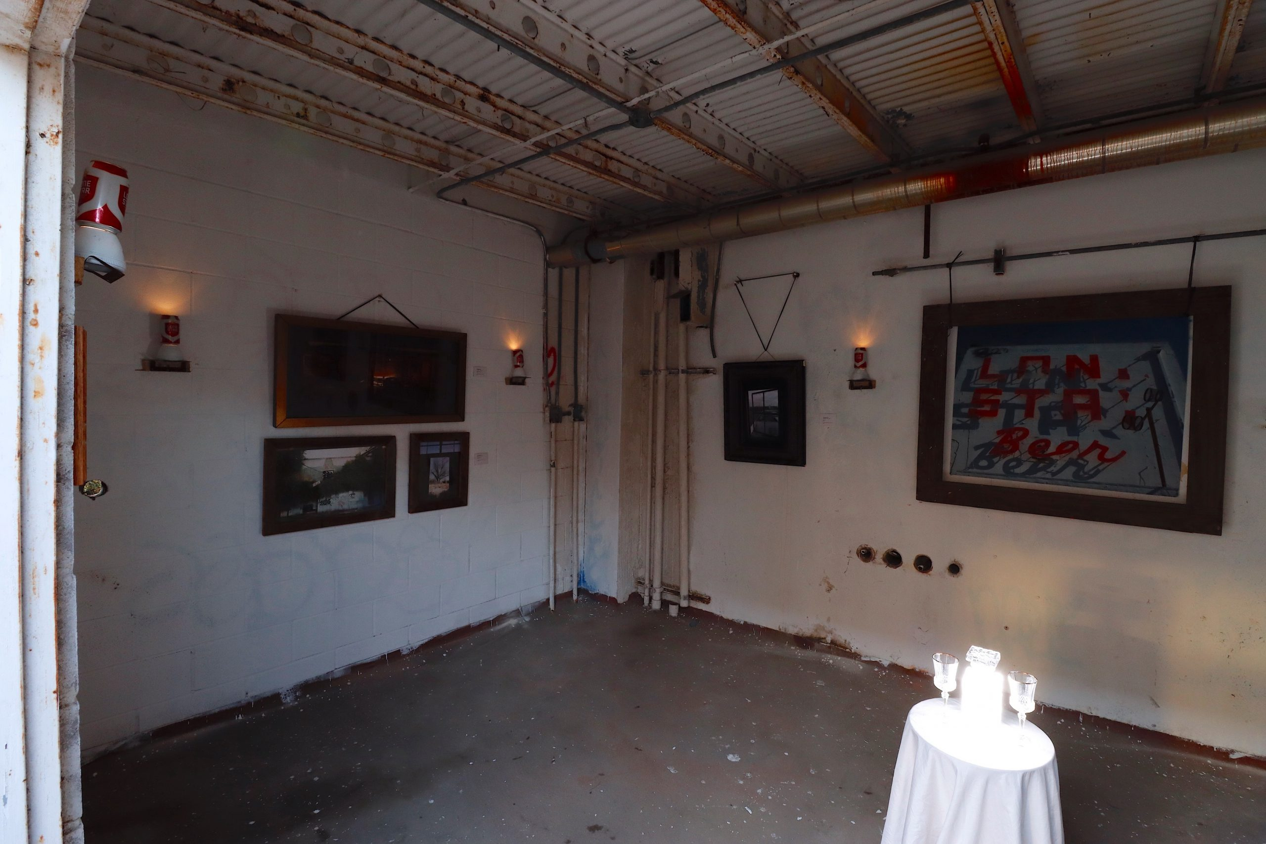 Finished and framed artwork hangs in the Krook Gallery at Lonestar Brewery upon completion.