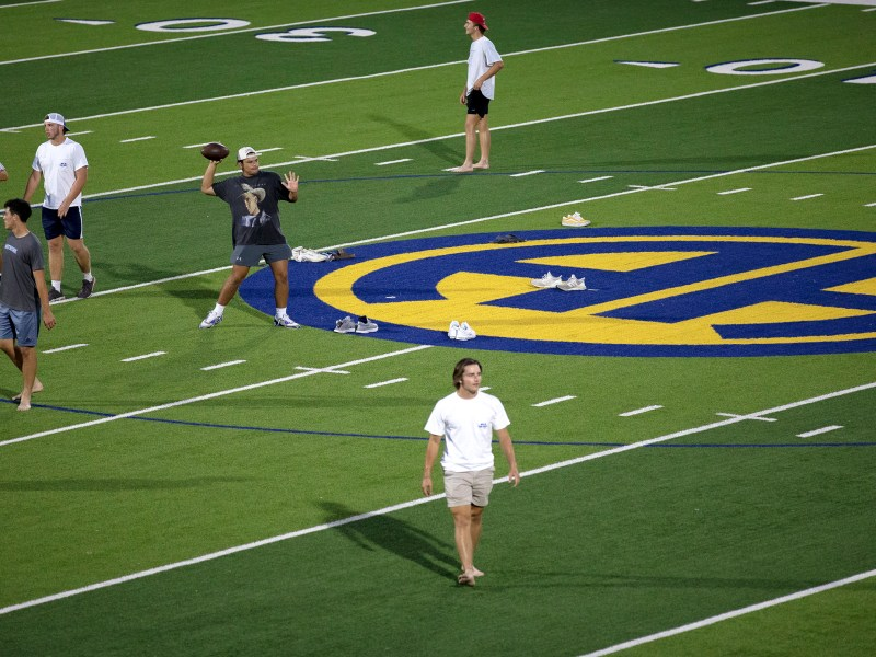 Alamo Heights football players experience being under the lights at the newly renovated Harry B. Orem stadium on Thursday.