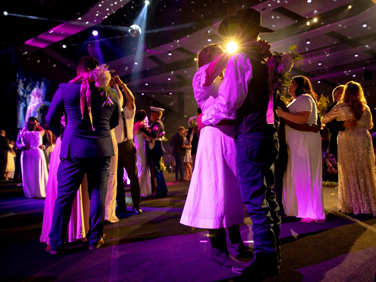 Matthew Rodriguez dances with his wife, Lucy, alongside 51 other couples during a mass wedding ceremony at Community Bible Church on Saturday.