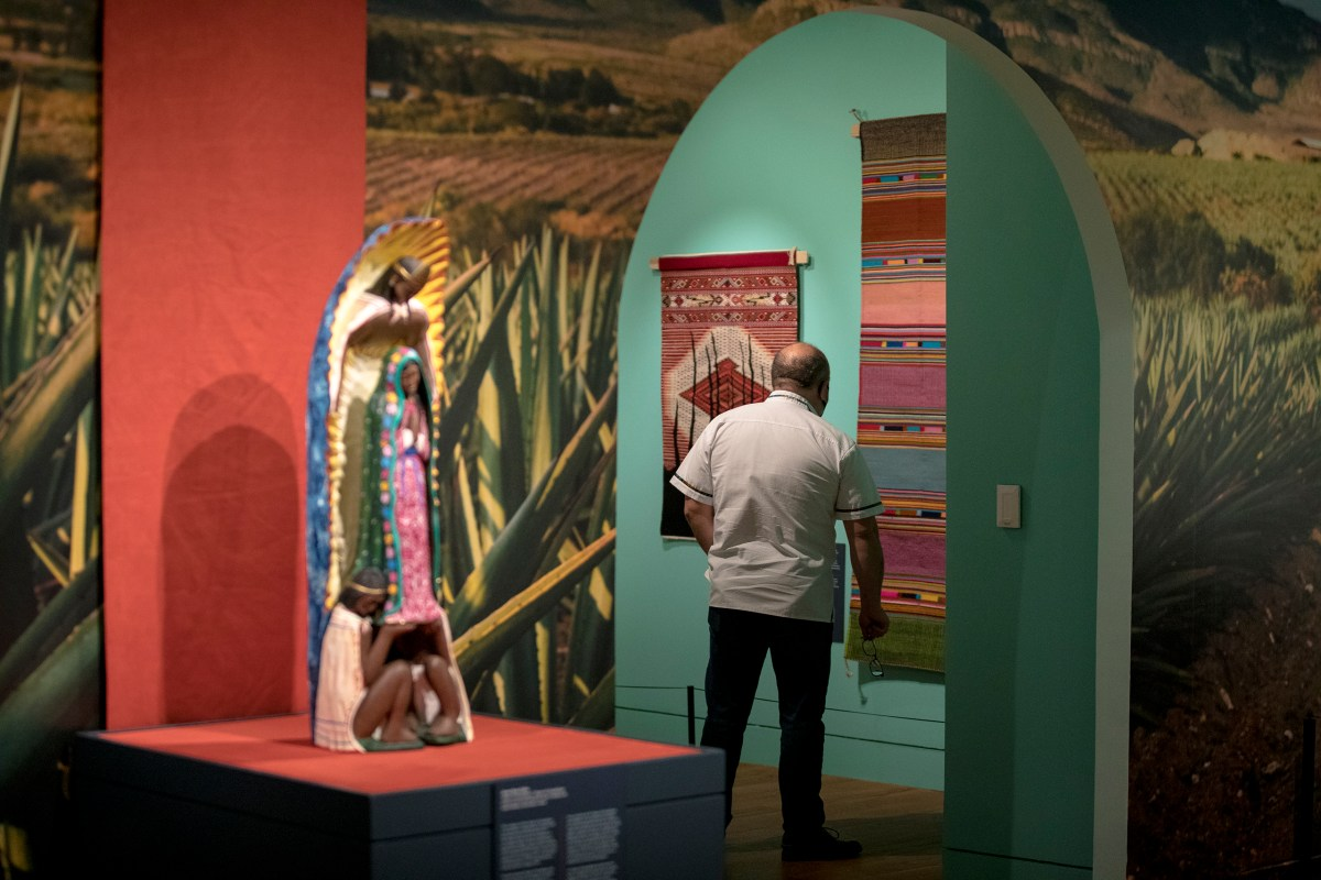 A man looks at a textile at the Witte Museum's Orale! The Magical Art of Oaxaca exhibit on Friday.