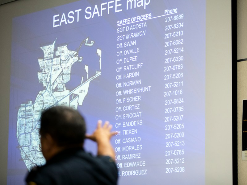 San Antonio police officer Pete Ovalle motions to a map outlining officers and their coverage areas during a neighborhood watch class on Wednesday.