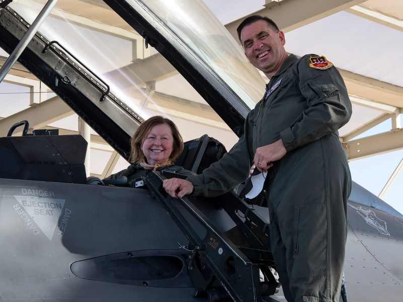 San Antonio Report reporter Shari Biediger poses for a photo with her husband, Lt. Col. Charlie Biediger, before taking a high-speed taxi ride in an F-16 fighter jet.
