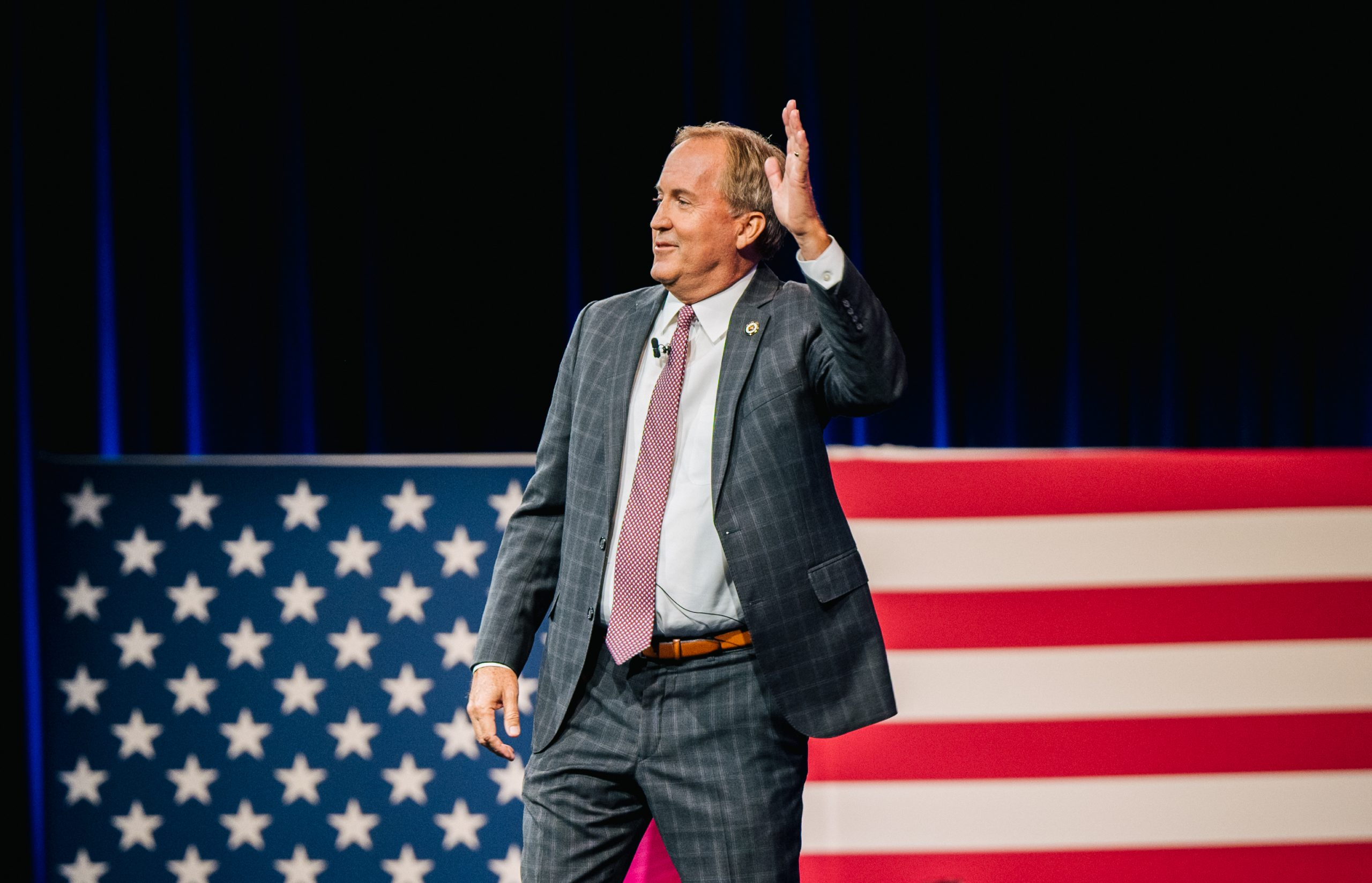 Texas Attorney General Ken Paxton waves after speaking during the Conservative Political Action Conference CPAC held at the Hilton Anatole on July 11, 2021 in Dallas, Texas.