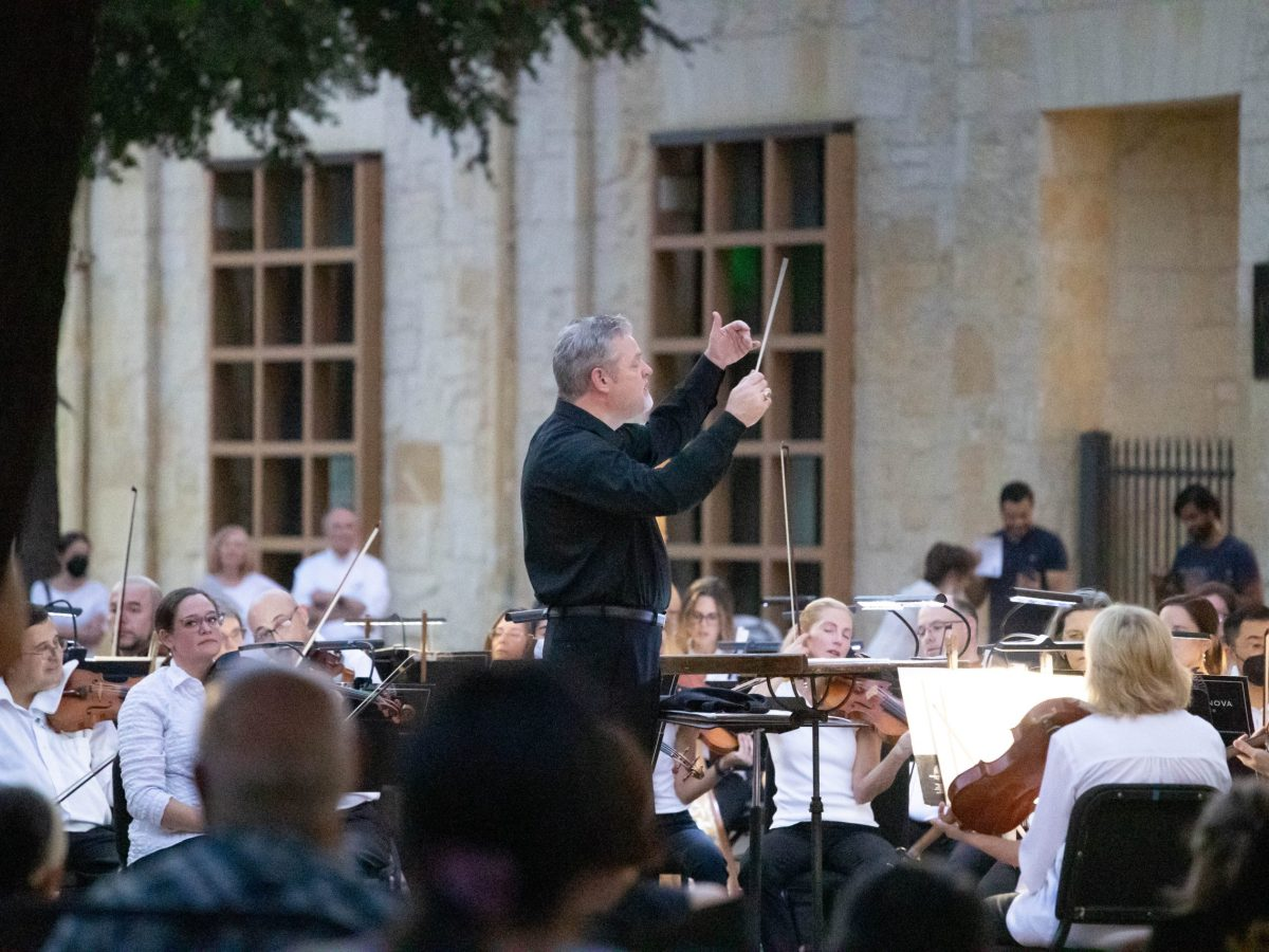 Troy Peters conducts the San Antonio Symphony during a performance in Main Plaza Saturday evening.